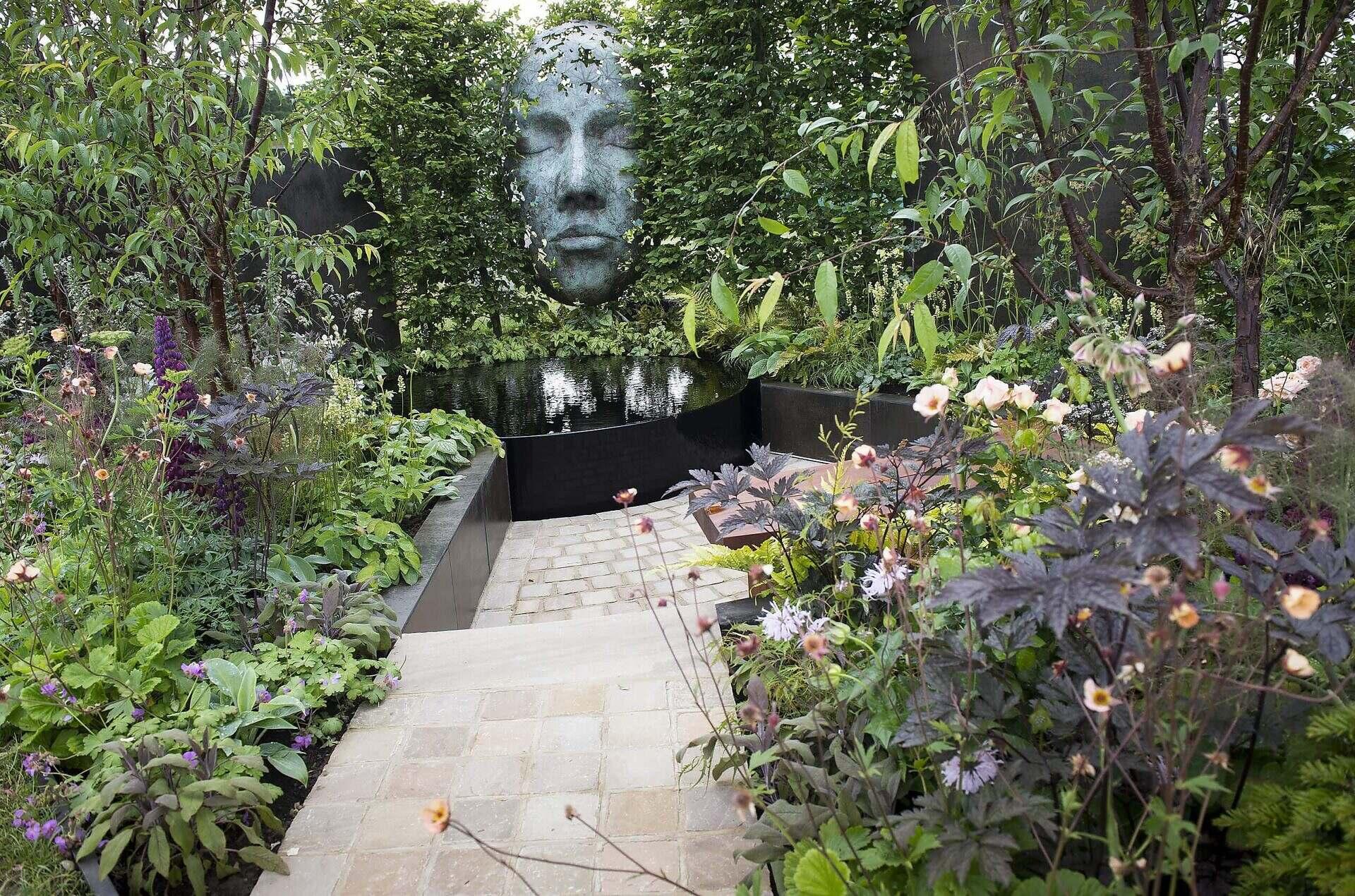 Show garden at RHS Chatsworth showing sculpture