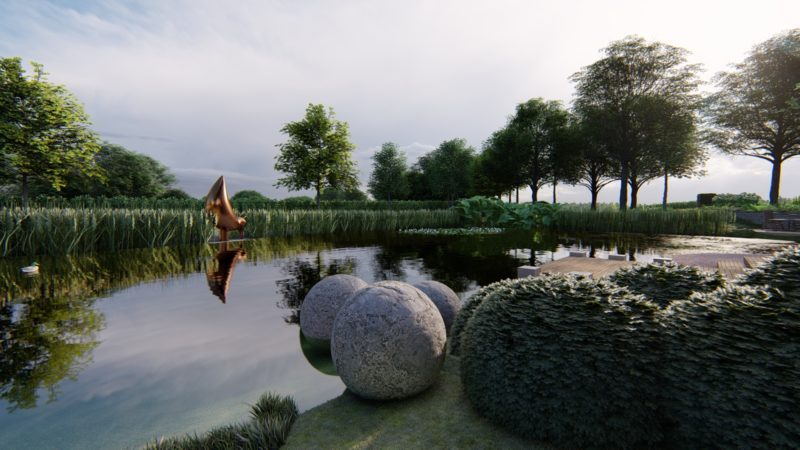 sculpture next to a lake in large country garden design