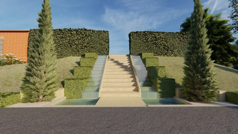 water cascades either side of entrance steps within large country garden design
